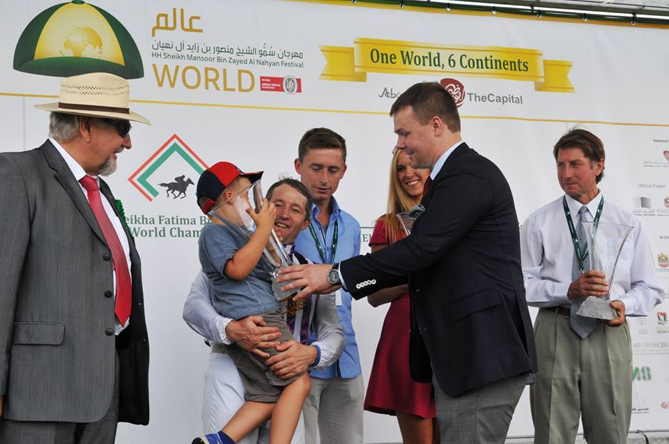 AHCII chairman Lucas Luniewski handling over the prizes for the race sponsored by the Arabian Horse Culture International Institute that took place within the United Arab Emirates Day and Sheikh Zayed Al Nahyan Festival at the racecourse. Summer 2015 http://www.arabianhorseculture.com/